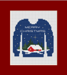 "An original cross stitch card with the inscription in English: ""Merry Christmas""."