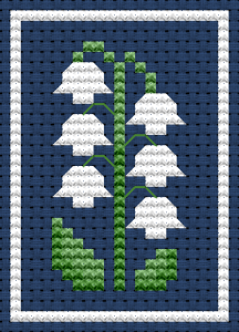 Miniature floral cross stitch pattern with lily of the valley for small cards, jewelry, and other projects.
