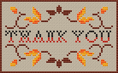 Stylized cross stitch motif of branches and golden leaves.