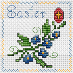Small Easter card with blue flowers and traditional red egg and cross.Text: Easter