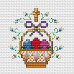Lovely cross stitch pattern of a basket with Easter eggs and flowers.