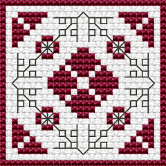 Decorative biscornu in red and black. Depicts geometric floral motifs using back and full stitches.