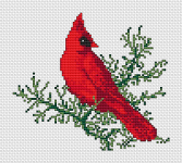 Cross stitch pattern of a red cardinal bird, resting on a tree-branch.