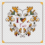 Small cross stitch pattern depicting a heart of autumn leaves.