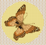 Wonderful cross stitch of a butterfly in warm, brown colors.