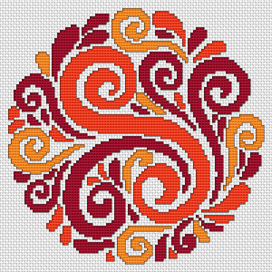 Multicolored decorative ornament of flowers in warm red, orange and yellow colors.