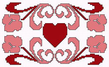 Decorative cross stitch of a heart with flowers celebrating Valentine's day.