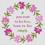 Floral wreath cross stitch pattern with a quote by John Heider: 