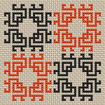 Geometric biscornu motif of four stylized flowers in orange and black. Ideal for beginners, stitched only with full-stitches.
