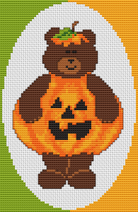 Cute Teddy in Halloween pumpkin costume ready for the party.