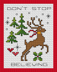 Cross stitch card with Christmas elements:reindeer,trees,red hearts.The text is:Don't stop believing
