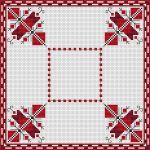 Traditional Bulgarian embroidery in red colors with a border in red and black.