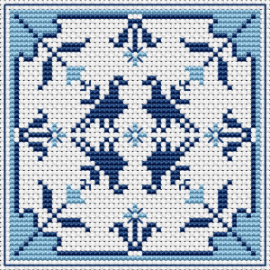 Blue biscornu pattern with abstract flowers and birds.