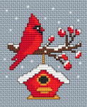 Christmas card cross stitch pattern with a cute red cardinal bird perched on a branch  and enjoying the snow.