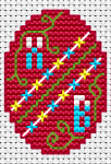Miniature cross stitch pattern for a Easter card with a traditional red egg decorated with stylized spring flowers.
