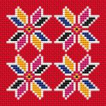 Colorful floral motif on red Aida suitable for biscornu making and other cross stitch projects.