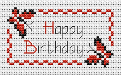 Happy birthday cross stitch card with two playful butterflies.