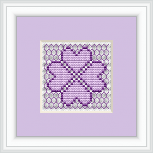 An interesting small pattern with a stylized four-leaf clover with gentle purple shades and backstitches for background.