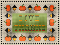 "A simple,pretty and festive cross stitch card with the text:""Give Thanks""."