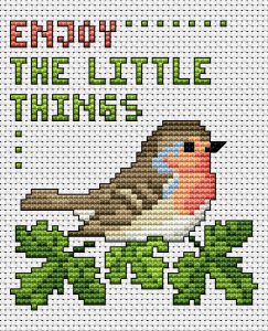 "Beautiful and colorful cross stitch card with a little bird and the text.""Enjoy the little things""."