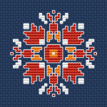 Small ornament in bright orange and yellow colors on dark blue Aida 14 ct.Suitable for lovers of embroidered jewelry.
